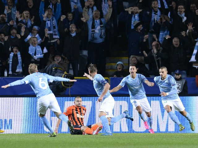 Malmo's Swedish forward Markus Rosenberg (C) celebrates with his teammates after scoring the opening goal during the UEFA Champions League Group A, first-leg football match between Malmo FF and FC Shakhtar Donetsk in Malmo, Sweden on October 21, 2015.