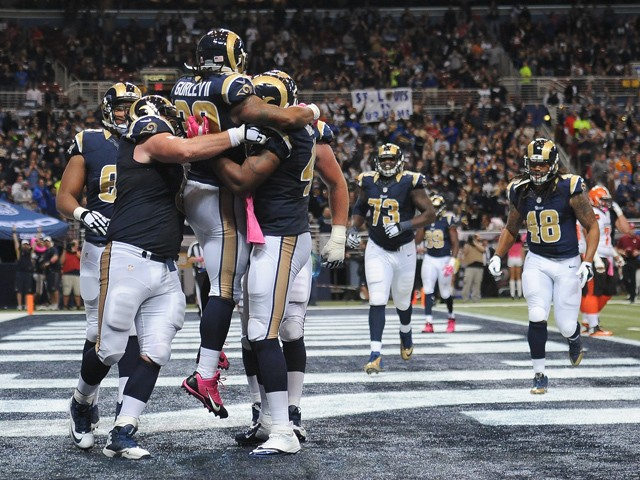 Todd Gurley celebrates with teammates after scoring a touchdown against the Cleveland Browns in the third quarter at the Edward Jones Dome on October 25, 2015