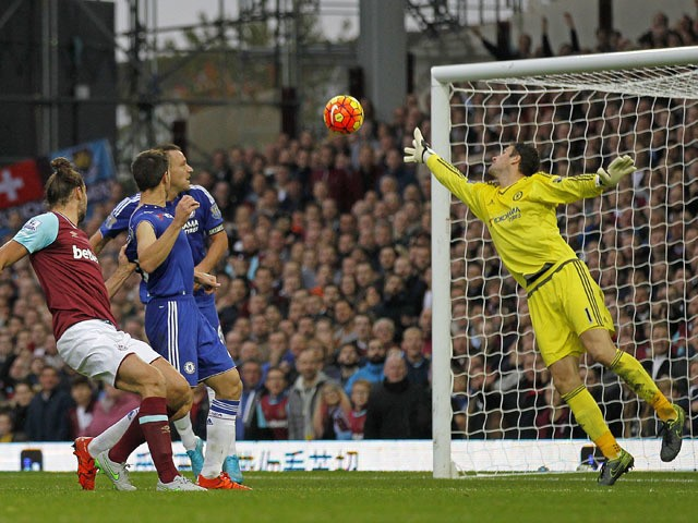 West Ham United's English striker Andy Carroll (2nd L) scores his team's second goal during the English Premier League football match between West Ham United and Chelsea at The Boleyn Ground in Upton Park, east London on October 24, 2015