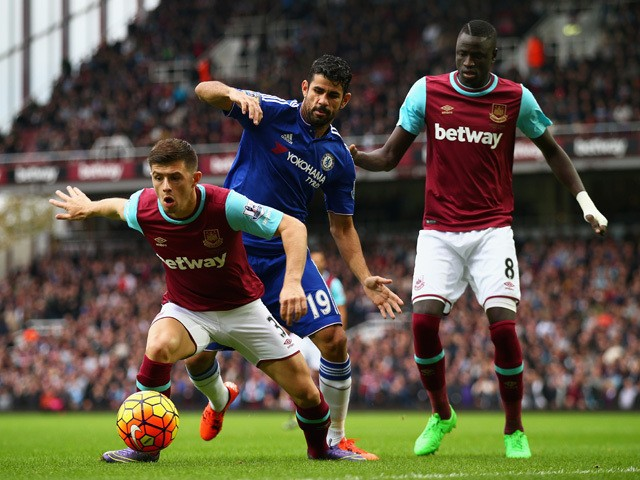 Aaron Cresswell of West Ham United and Diego Costa of Chelsea compete for the ball during the Barclays Premier League match between West Ham United and Chelsea at Boleyn Ground on October 24, 2015