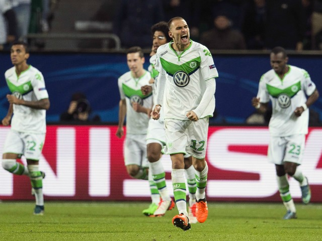 Wolfsburg's forward Bas Dost of the Netherlands celebrates scoring the opening goal during the Group B, first-leg UEFA Champions League football match VfL Wolfsburg vs PSV Eindhoven in Wolfsburg, northern Germany on October 21, 2015.