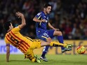Barcelona's midfielder Sergio Busquets (L) vies with Getafe's midfielder Pablo Sarabia during the Spanish league football match Getafe CF vs FC Barcelona at the Coliseum Alfonso Perez stadium in Getafe on October 31, 2015.