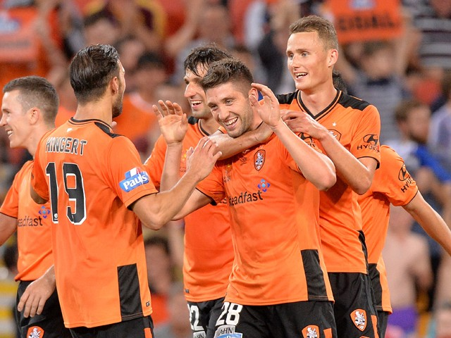 Brandon Borrello of the Roar celebrates with team mates after scoring a goal during the round four A-League match between Brisbane Roar and Adelaide United at Suncorp Stadium on October 31, 2015