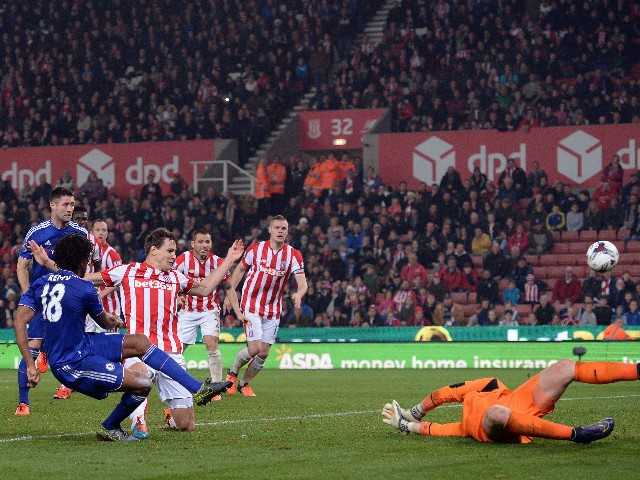 Chelsea's French striker Loic Remy shoots to score his team's first goal during the English League Cup fourth round football match between Stoke City and Chelsea at the Britannia Stadium in Stoke-on-Trent, central England on October 27, 2015.