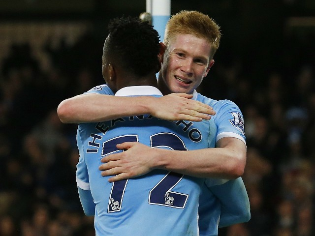 Manchester City's Belgian midfielder Kevin De Bruyne (R) celebrates with Manchester City's Nigerian striker Kelechi Iheanacho after scoring their second goal during the English League Cup fourth round football match between Manchester City and Crystal Pal