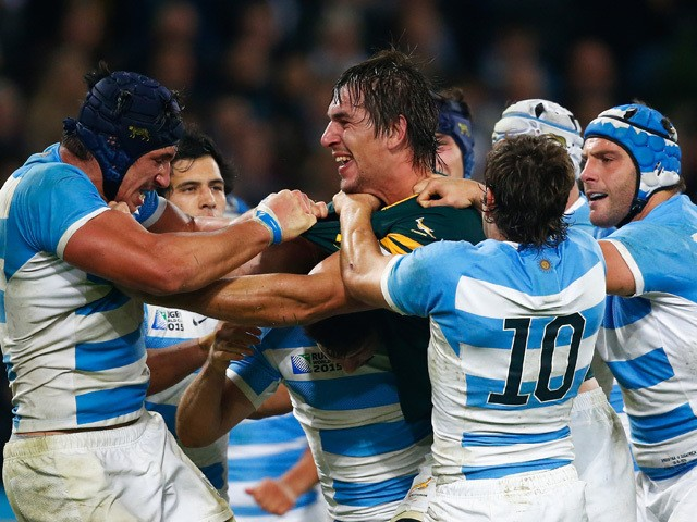 Eben Etzebeth of South Africa clashes with Tomas Lavanini and Nicolas Sanchez of Argentina during the 2015 Rugby World Cup Bronze Final match between South Africa and Argentina at the Olympic Stadium on October 30, 2015