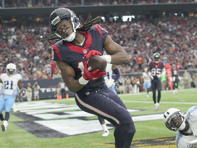 DeAndre Hopkins #10 of the Houston Texans makes a touchdown catch against Jason McCourty #30 of the Tennessee Titans in the second quarter on November 1, 2015