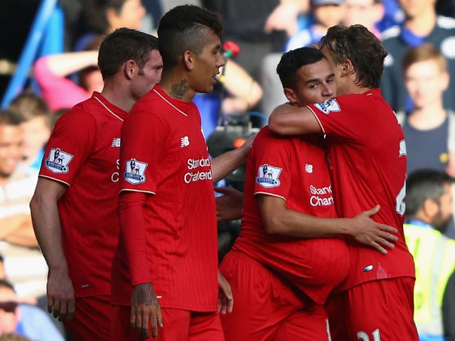 Philippe Coutinho (2nd R) of Liverpool celebrates scoring his team's first goal with his team mates during the Barclays Premier League match between Chelsea and Liverpool at Stamford Bridge on October 31, 2015