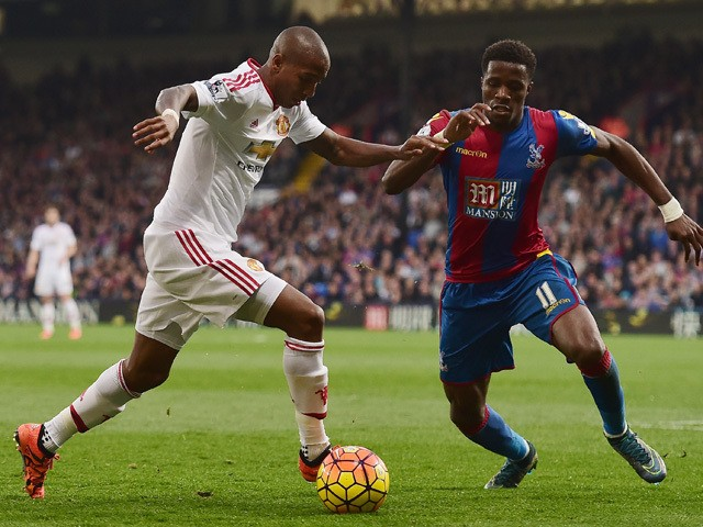 Ashley Young of Manchester United and Wilfried Zaha of Crystal Palace compete for the ball during the Barclays Premier League match between Crystal Palace and Manchester United at Selhurst Park on October 31, 2015