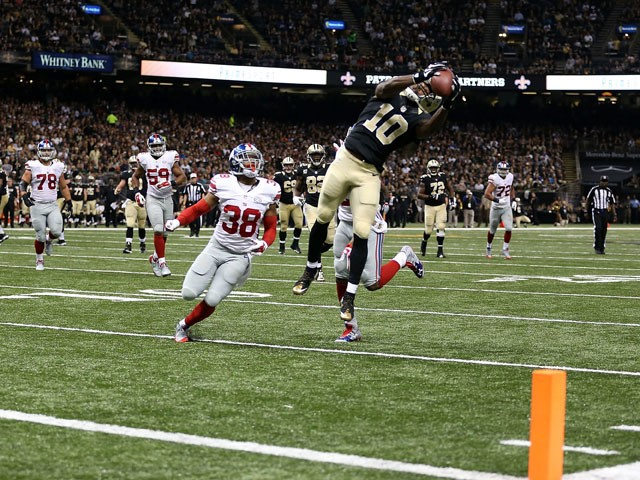 Brandin Cooks #10 of the New Orleans Saints catches a pass for a touchdown during the third quarter of a game against the New York Giants at the Mercedes-Benz Superdome on November 1, 2015