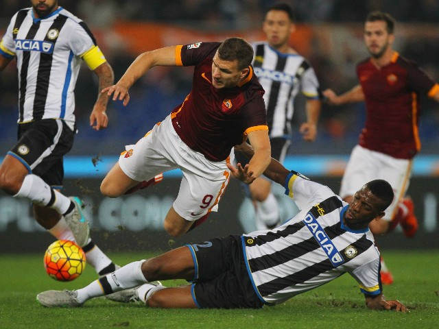 Edin Dzeko (L) of AS Roma competes for the ball with Molla Vague of Udinese Calcio during the Serie A match between AS Roma and Udinese Calcio at Stadio Olimpico on October 28, 2015 in Rome, Italy.