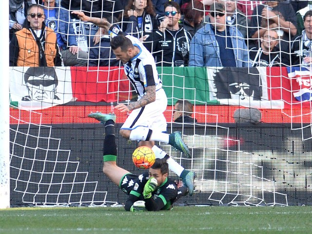 Andrea Cosigli goalkeeper of US Sassuolo makes a save at the feet of Cyril Thereau of Udinese Calcio during the Serie A match between Udinese Calcio and US Sassuolo Calcio at Stadio Friuli on November 1, 2015