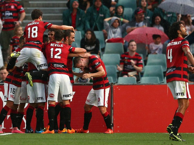 Wanderers players celebrate a goal by Dario Vidosic during the round four A-League match between the Western Sydney Wanderers and Perth Glory at Pirtek Stadium on November 1, 2015
