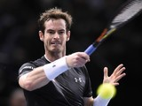 Britain's Andy Murray returns the ball to Spain's David Ferrer during their semi-final tennis match at the ATP World Tour Masters 1000 indoor tennis tournament in Paris on November 7, 2015.