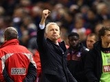 Alan Pardew, Manager of Crystal Palace celebrates towards the fans following the Barclays Premier League match between Liverpool and Crystal Palace at Anfield on November 8, 2015