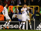 Harry Kane (R) of Spurs is congratulated by teammates Kieran Trippier (C) and Ryan Mason (L) after scoring the opening goal during the UEFA Europa League Group J match between Tottenham Hotspur FC and RSC Anderlecht at White Hart Lane on November 5, 2015