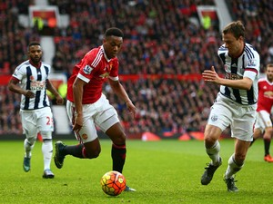 Anthony Martial of Manchester United and Jonny Evans of West Bromwich Albion compete for the ball during the Barclays Premier League match between Manchester United and West Bromwich Albion at Old Trafford on November 7, 2015 in Manchester, England.