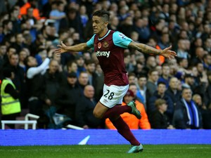 Manuel Lanzini of West Ham United celebrates scoring his team's first goal during the Barclays Premier League match between West Ham United and Everton at Boleyn Ground on November 7, 2015 in London, England.