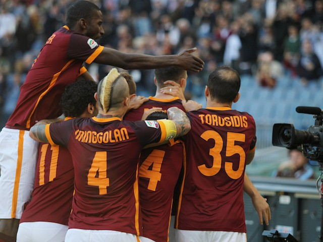 Edin Dzeko of AS Roma with team mates celebrate him scoring the opening goal from penalty spot during the Serie A match between AS Roma and SS Lazio at Stadio Olimpico on November 8, 2015 in Rome, Italy.