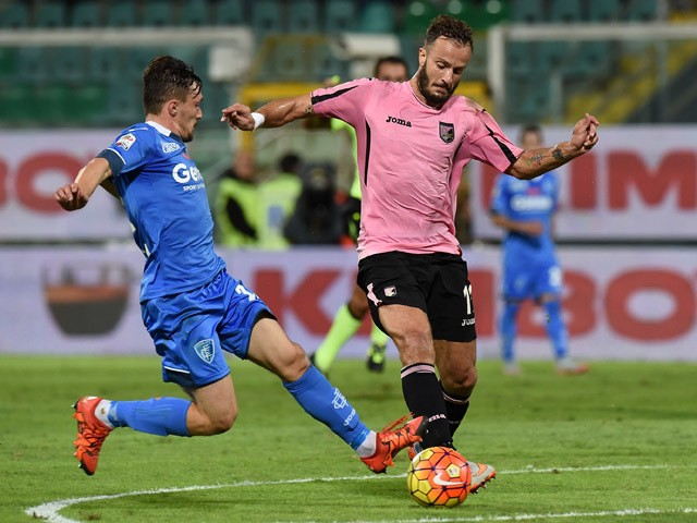 Alberto Gilardino (R) of Palermo is challenged by Silva Mario Rui of Empoli compete for the ball during the Serie A match between US Citta di Palermo and Empoli FC at Stadio Renzo Barbera on November 2, 2015