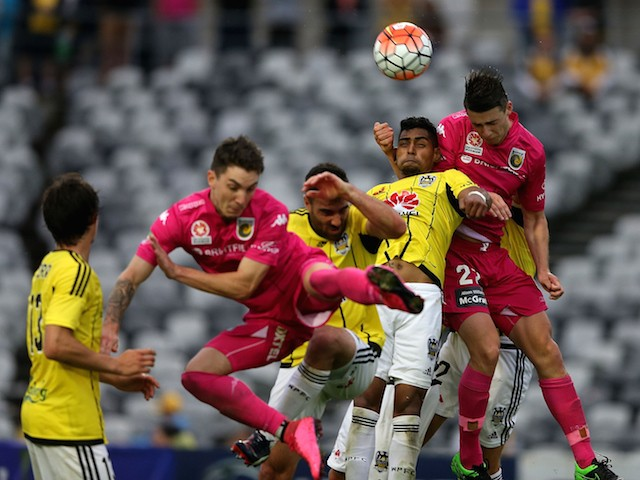 Roy Krishna of the Phoenix contests the header against Jake McGing of the Mariners during the round five A-League match between the Central Coast Mariners and the Wellington Phoenix at Central Coast Stadium on November 8, 2015 in Gosford, Australia.