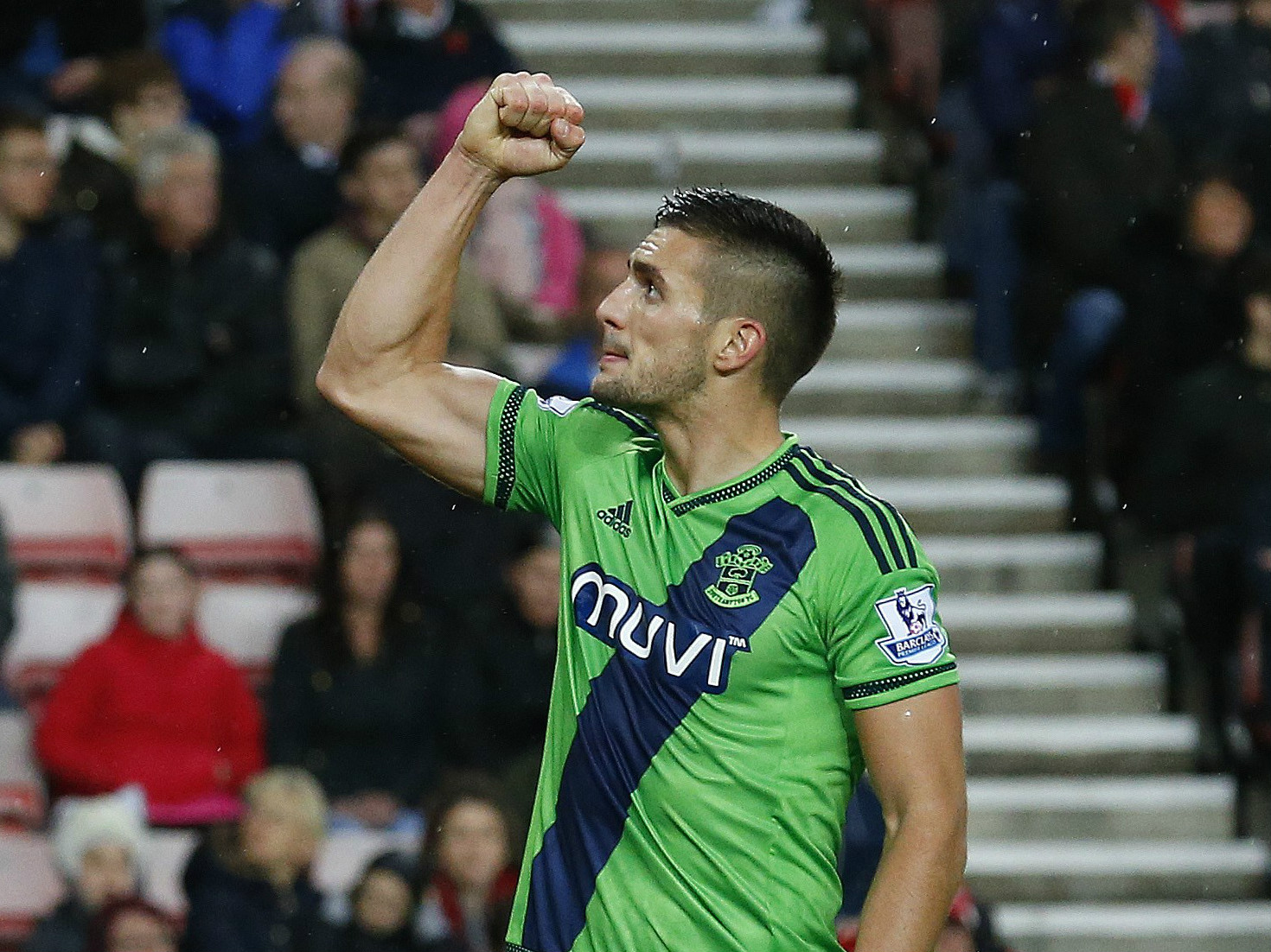 Southampton's Serbian midfielder Dusan Tadic celebrates after scoring the opening goal from the penalty spot during the English Premier League football match between Sunderland and Southampton at the Stadium of Light in Sunderland, north east England on N