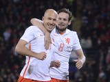 Netherlands' midfielder Arjen Robben (L) celebrates with Netherlands' midfielder Daley Blind (R) after scoring Netherlands' second goal during the international friendly football match between Wales and Netherlands at Cardiff City Stadium in south Wales o