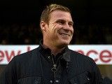 David Flitcroft, Manager of Bury smiles during the Capital One Cup second round match between Bury and Leicester City at Gigg Lane on August 25, 2015