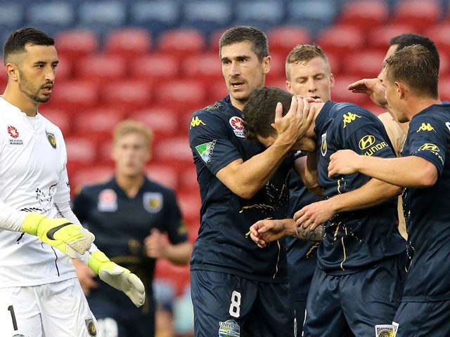 Mariners players celebrate during the round six A-League match between the Newcastle Jets and the Central Coast Mariners at Hunter Stadium on November 14, 2015