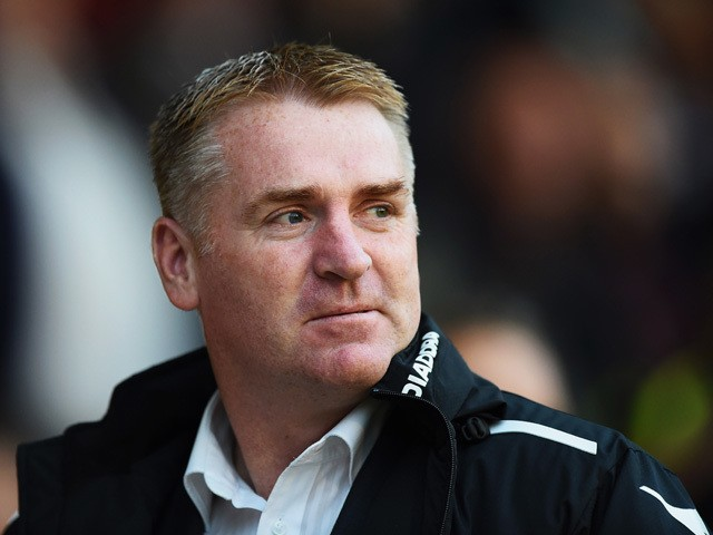 Dean Smith, manager of Walsall looks on prior to the Capital One Cup Second Round match between Walsall and Crystal Palace at Banks' Stadium on August 26, 2014