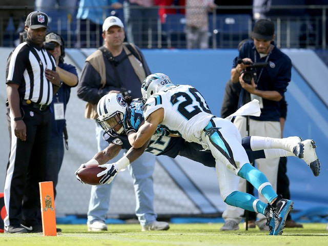 Dexter McCluster #22 of the Tennessee Titans dives for the end zone past Kurt Coleman #20 of the Carolina Panthers during the first quarter at LP Field on November 15, 2015
