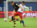 Dortmund's defender Matthias Ginter (L) and Hamburg's Croatian midfielder Ivo Ilicevic vie for the ball during the German first division football Bundesliga match between Hamburg SV and Borussia Dortmund in Hamburg, northern Germany on November 20, 2015.