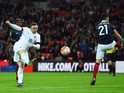 Wayne Rooney of England scores his team's second goal during the International Friendly match between England and France at Wembley Stadium on November 17, 2015