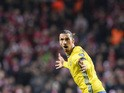 Sweden's forward and team captain Zlatan Ibrahimovic celebrates after scoring his second goal during the Euro 2016 second leg play-off football match between Denmark and Sweden at Parken stadium in Copenhagen on November 17, 2015