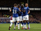 Romelu Lukaku (2nd L) of Everton celebrates scoring his team's second goal with his team mates during the Barclays Premier League match between Everton and Aston Villa at Goodison Park on November 21, 2015