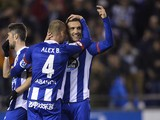 Deportivo La Coruna's midfielder Lucas Perez (R) hugs his teammate midfielder Alex Bergantinos after scoring their second goal during the Spanish league football match RC Deportivo La Coruna vs Celta Vigo at the Municipal de Riazor stadium in La Coruna on