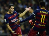 Barcelona's Uruguayan forward Luis Suarez (L) celebrates a goal with Barcelona's Brazilian forward Neymar during the Spanish league 'Clasico' football match Real Madrid CF vs FC Barcelona at the Santiago Bernabeu stadium in Madrid on November 21, 2015.