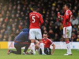 Phil Jones (2nd R) of Manchester United receives medical treatment during the Barclays Premier League match between Watford and Manchester United at Vicarage Road on November 21, 2015