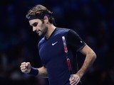 Switzerland's Roger Federer wins a point against Switzerland's Stan Wawrinka during the men's singles semi-final match on day seven of the ATP World Tour Finals tennis tournament in London on November 21, 2015.
