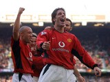 Manchester United's Ruud van Nistelrooy celebrates after scoring his hat trick (3 goals) against Newcastle City during their Premiership clash at Old Trafford in Manchester 23 November 2002
