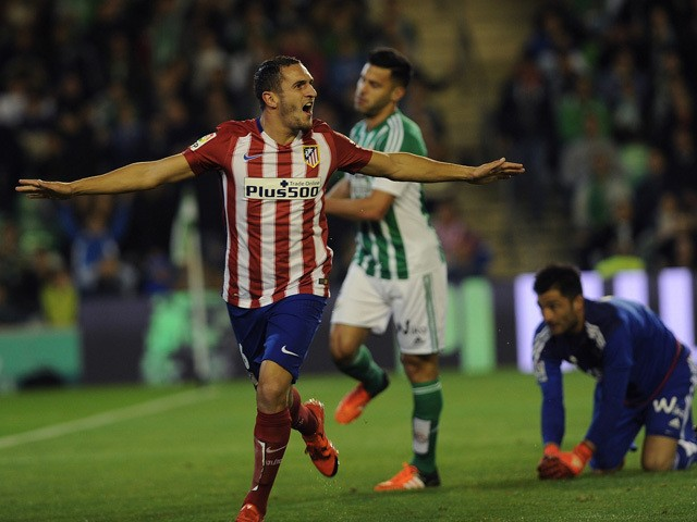 Atletico Madrid's midfielder Koke (L) celebrates after scoring a goal during the Spanish league football match Real Betis Balompie vs Club Atletico de Madrid at the Benito Villamarin stadium in Sevilla on November 22, 2015