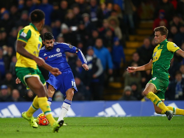 Diego Costa (C) of Chelsea scores his team's first goal during the Barclays Premier League match between Chelsea and Norwich City at Stamford Bridge on November 21, 2015