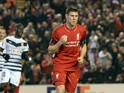 Liverpool's English midfielder James Milner (C) celebrates after scoring from the penalty spot during a UEFA Europa League group B football match between Liverpool and Bordeaux at Anfield in Liverpool, north west England, on November 26, 2015.