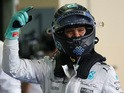 Mercedes AMG Petronas F1 Team's German driver Nico Rosberg celebrates after the qualifying session at the Yas Marina circuit in Abu Dhabi on November 28, 2015