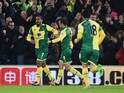 Lewis Grabban of Norwich City (7) celebrates with Jonathan Howson (8) as he scores their first and equalising goal during the Barclays Premier League match between Norwich City and Arsenal at Carrow Road on November 29, 2015