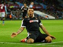 Troy Deeney of Watford celebrates scoring his team's third goal during the Barclays Premier League match between Aston Villa and Watford at Villa Park on November 28, 2015