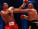 World heavyweight boxing champion Wladimir Klitschko (L) of Ukraine defends against Britain's Tyson Fury during their WBA, IBF, WBO and IBO title bout in Duesseldorf, western Germany, on November 28, 2015. Fury dethroned Klitschko in a 12round decision to