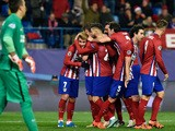 Atletico Madrid's players congratulate teammate French forward Antoine Griezmann (L) after scoring a second goal during the UEFA Champions League Group C football match Club Atletico de Madrid vs Galatasaray AS at the Vicente Calderon stadium in Madrid on
