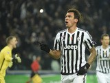 Juventus' forward from Croatia Mario Mandzukic celebrates after scoring during the UEFA Champions League football match Juventus vs Manchester City on November 25, 2015