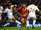 Swansea City's English defender Kyle Bartley vies with Liverpool's English midfielder Adam Lallana (2nd R) during the English Premier League football match between Liverpool and Swansea City at the Anfield stadium in Liverpool, north-west England on Novem